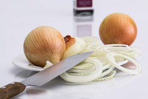 onions on plate with knife